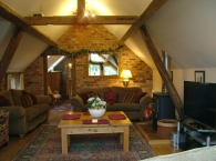 Billys-Bothy-lounge-with-wood-burner-and-w-fi